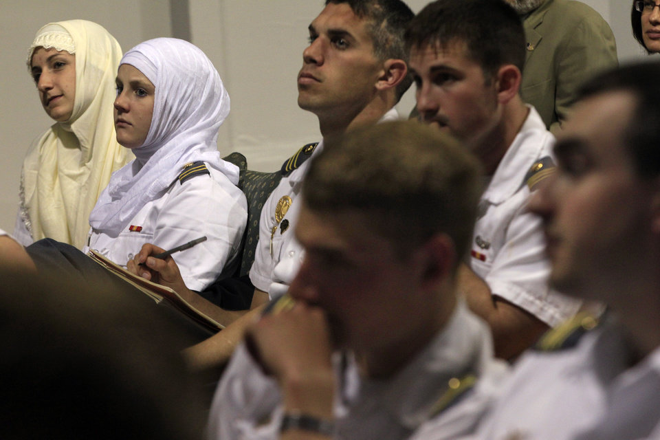 Photo -   Senior Megan Kelty, left, and junior Jordan Reilly, second left, wear Muslim headscarves out of respect, as they sit with other cadets from the U.S. Military Academy at West Point, N.Y., during a presentation at the Islamic Center of Jersey City Thursday, April 26, 2012, in Jersey City, N.J. The city of 250,000 is one of the most ethnically and religiously diverse places in America, and the cadets are visiting as part of a class at West Point on peacekeeping and reconstruction called