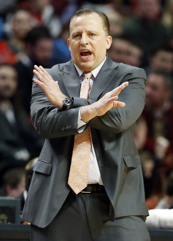 Photo - Chicago Bulls coach Tom Thibodeau gives instructions to his team during the first half of an NBA basketball game against the Phoenix Suns in Chicago on Saturday, Jan. 12, 2013. (AP Photo/Nam Y. Huh)