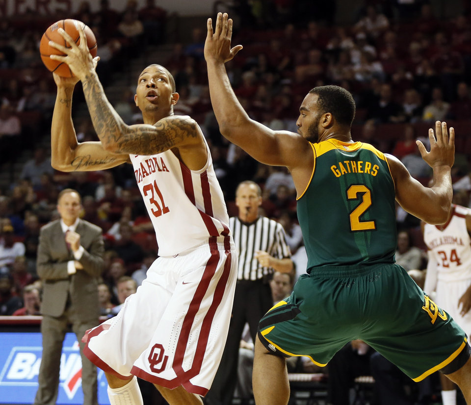 Photo - Oklahoma's D.J. Bennett (31) tries to get the ball past Baylor's Rico Gathers (2) during an NCAA men's college basketball game between Baylor and the University of Oklahoma at Lloyd Noble Center in Norman, Okla., Saturday, Feb. 8, 2014. OU won, 88-72. Photo by Nate Billings, The Oklahoman