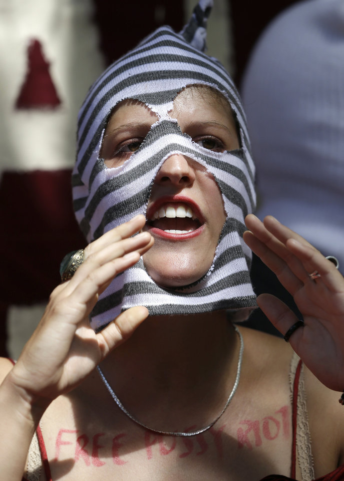 Photo -   A Supporter of the Russian punk rock band Pussy Riot protests outside the Russian Embassy in London, Friday, Aug. 17, 2012, as the verdict in their case is announced in Moscow. A Russian judge found three members of the provocative punk band Pussy Riot guilty of hooliganism on Friday, in one of the most closely watched cases in recent Russian history. The judge said the three band members committed hooliganism driven by religious hatred and offending religious believers. The three were arrested in March after a guerrilla performance in Moscow's main cathedral calling for the Virgin Mary to protect Russia against Vladimir Putin, who was elected to a new term as Russia's president a few days later.(AP Photo/Alastair Grant)
