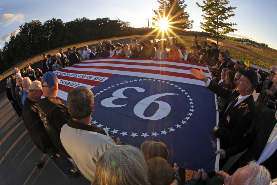 Visitors to the Flight 93 National Memorial in Shanksville, Pa., participate in a sunset memorial service on Monday, Sept. 10, 2012. Tuesday marks the 11th anniversary of the Sept. 11, 2001 terrorist attacks. (AP Photo/Gene J. Puskar)