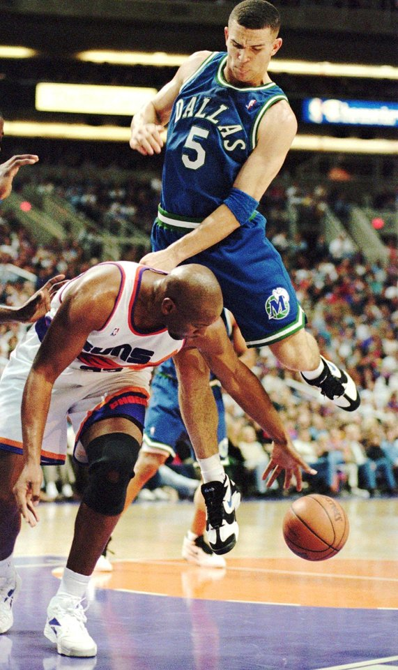 Dallas Mavericks guard Jason Kidd lands on top of Phoenix Suns forward Wayman Tisdale as the two tried to grab a rebound in the first quarter of their NBA basketball game in Phoenix Monday Dec. 26, 1994.   BLACK AND WHITE FIRST EDITION SPORTS          D27 KIDD
