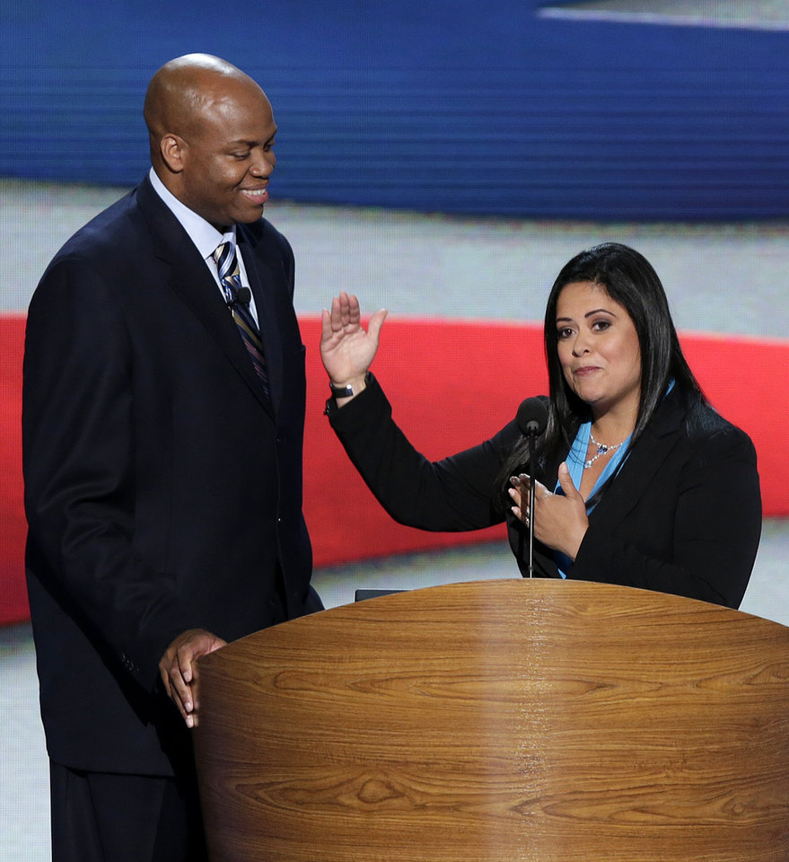 Photo - Maya Soetoro-ng, President Barack Obama's sister, right, and Craig Robinson, First Lady Michelle Obama's brother address the Democratic National Convention in Charlotte, N.C., on Tuesday, Sept. 4, 2012. (AP Photo/J. Scott Applewhite)  ORG XMIT: DNC169
