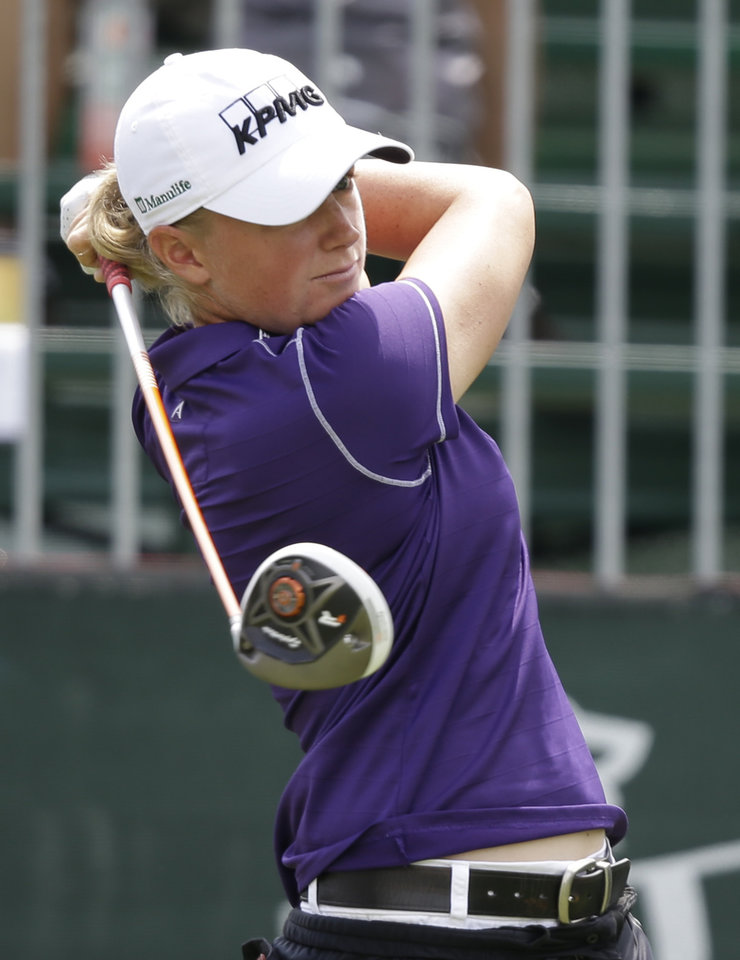 Photo - Stacy Lewis watches her tee shot on the first hole during the second round of the Kingsmill Championship golf tournament at the Kingsmill resort  in Williamsburg, Va., Friday, May 16, 2014. (AP Photo/Steve Helber)