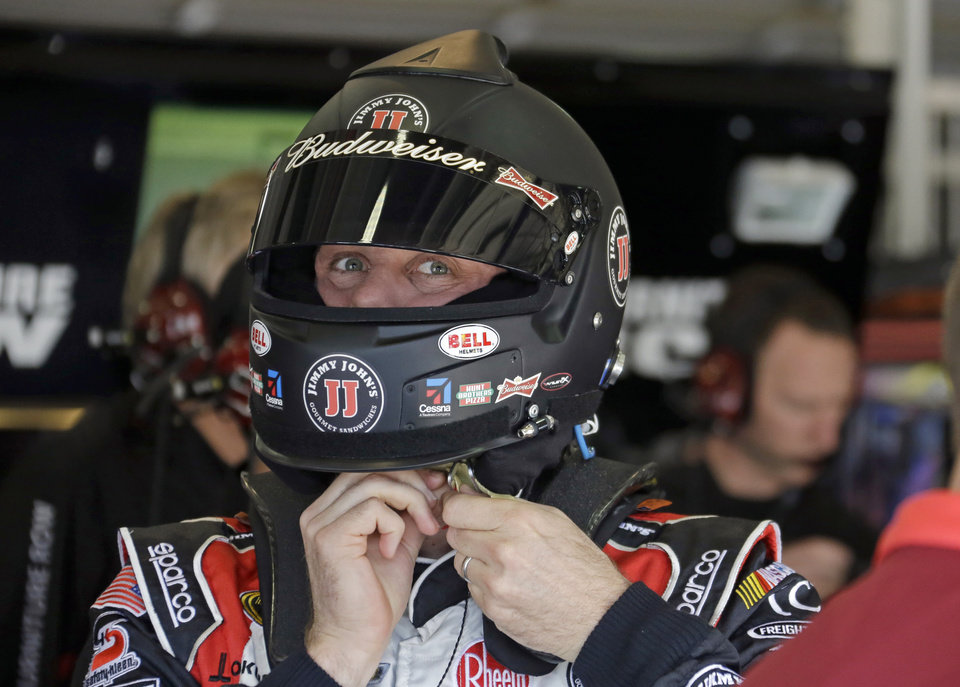 Kevin Harvick prepares for practice for the NASCAR Sprint Cup series auto race in Fontana, Calif., Friday, March 22, 2013. (AP Photo/Reed Saxon)