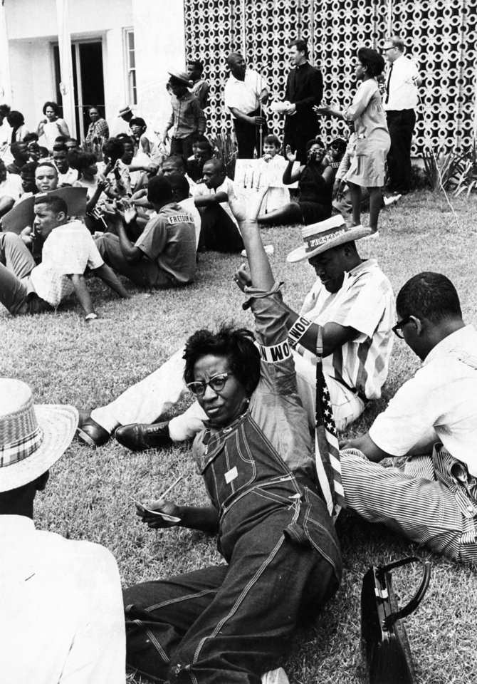 Photo - Mrs. Clara Luper of Oklahoma City signals a friend during a civil rights demonstration outside Lawton City Hall on 6/18/66.  The demonstrators were protesting the