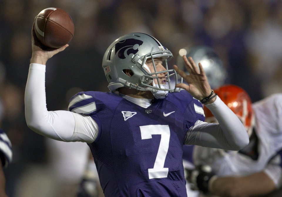 Kansas State quarterback Collin Klein (7) throws a pass during first half of an NCAA college football game against Oklahoma State in Manhattan, Kan., Saturday, Nov. 3, 2012. (AP Photo/Orlin Wagner)