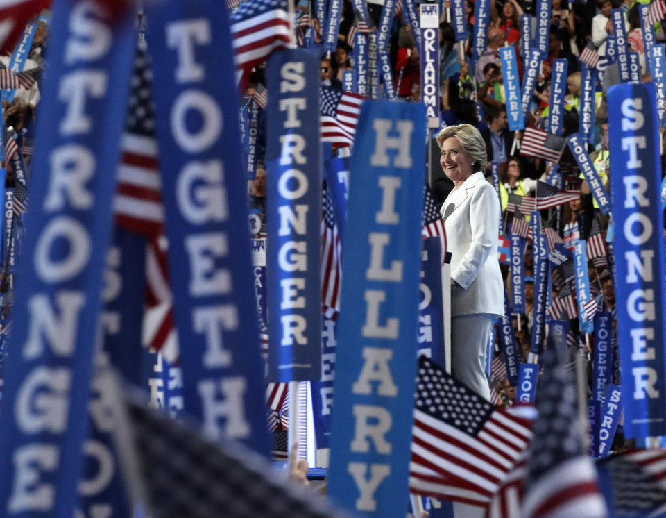 Photo - Democratic presidential nominee Hillary Clinton takes the stage to make her acceptance speech during the final day of the Democratic National Convention in Philadelphia , Thursday, July 28, 2016. (AP Photo/Paul Sancya)