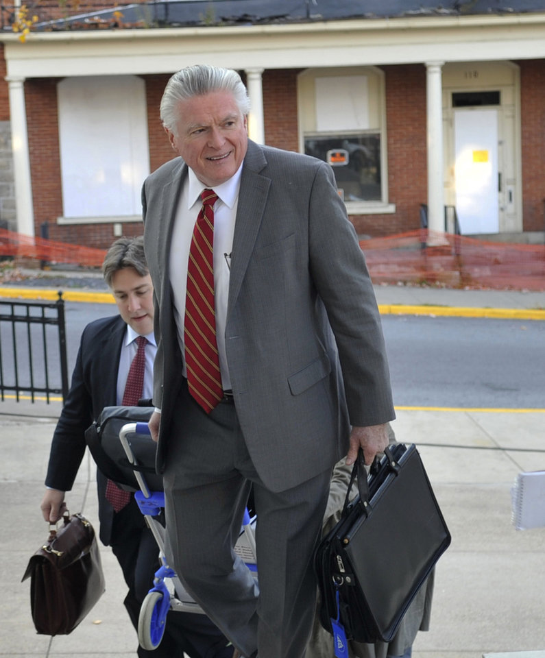 Photo - Tom Scott, attorney for the NCAA, enters the Centre County Courthouse, Tuesday, Oct. 29, 2013,  in Bellefonte, Pa., for a court hearing. Lawyers for the NCAA, the Paterno family and Paterno supporters were at the Centre County Courthouse, Tuesday for a court hearing on whether to allow a lawsuit filed against the NCAA by the family of longtime Penn State football coach Joe Paterno and others to go forward. The lawsuit brought by the Paterno family aims to wipe out the NCAA sanctions against Penn State University.  (AP Photo/Centre Daily Times, Nabil K. Mark) MAGS OUT MANDATORY CREDIT
