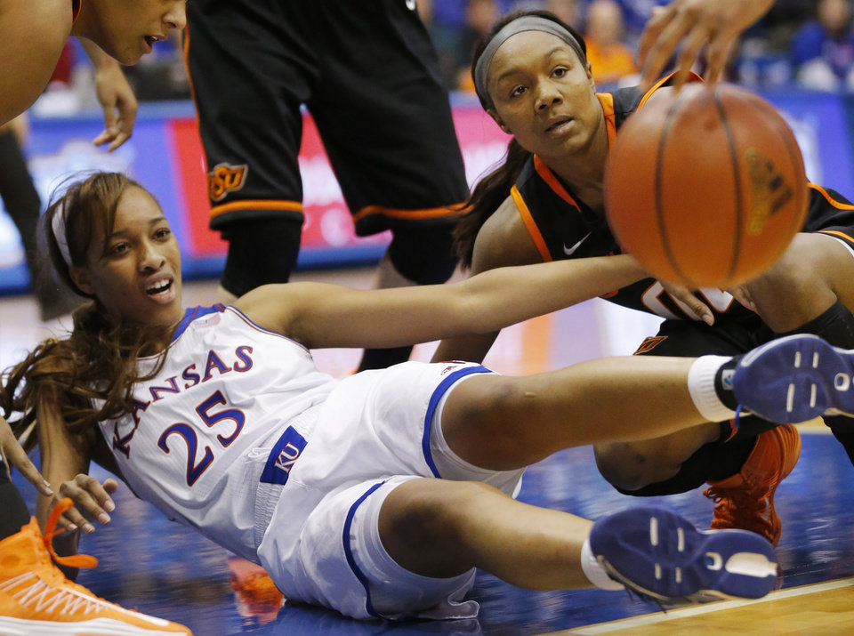 Photo - Kansas forward Caelynn Manning-Allen (25) and Oklahoma State guard Roshunda Johnson (00) hit the floor after a loose ball during the second half of an NCAA college basketball game in Lawrence, Kan., Wednesday, Jan. 22, 2014. Oklahoma State defeated Kansas 64-56.(AP Photo/Orlin Wagner)