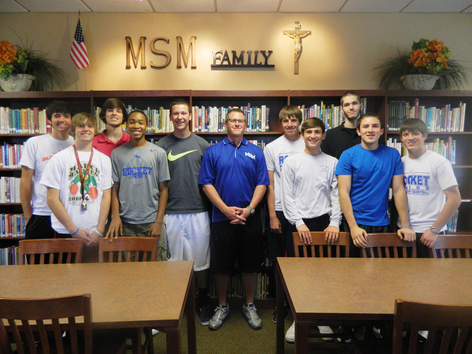 New Mt. St. Mary coach Andy Fisher with the Rockets' seniors-to-be