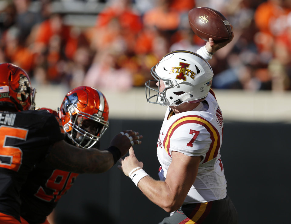Photo - Iowa State's Joel Lanning (7) throws as he is pressured by the OSU defense during a college football game between the Oklahoma State University Cowboys (OSU) and the Iowa State University at Boone Pickens Stadium in Stillwater, Okla., Saturday, Oct. 8, 2016. Photo by Sarah Phipps, The Oklahoman