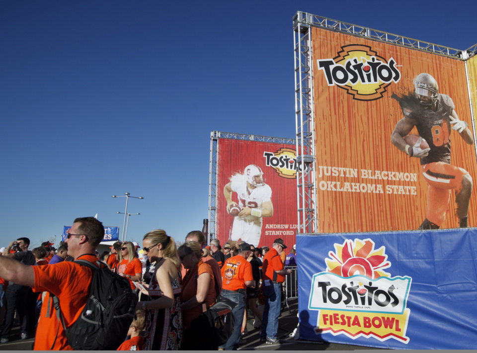 Photo - Fans walk through a fan zone the Fiesta Bowl between the Oklahoma State University Cowboys (OSU) and the Stanford Cardinal at the University of Phoenix Stadium in Glendale, Ariz., Monday, Jan. 2, 2012. Photo by Sarah Phipps, The Oklahoman