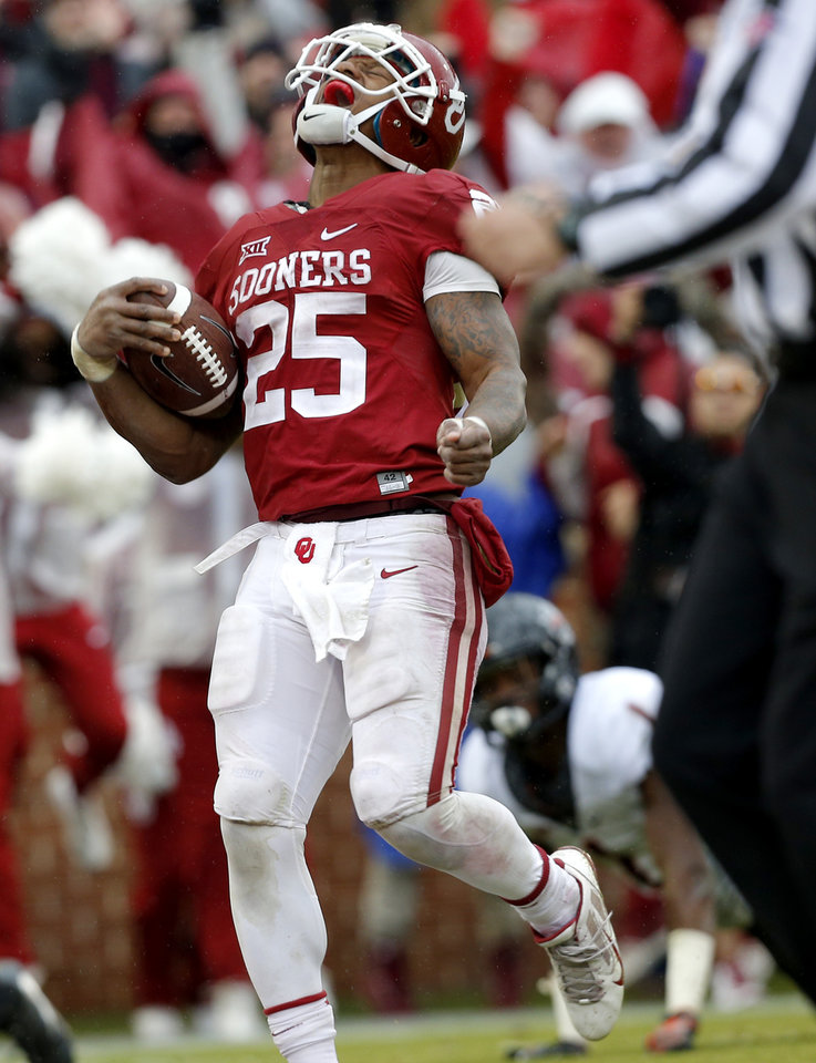 Photo - Oklahoma's Joe Mixon (25) celebrates his touchdown fourth quarter during the Bedlam college football game between the Oklahoma Sooners (OU) and the Oklahoma State Cowboys (OSU) at Gaylord Family - Oklahoma Memorial Stadium in Norman, Okla., Saturday, Dec. 3, 2016. OU won 38-20. Photo by Sarah Phipps, The Oklahoman