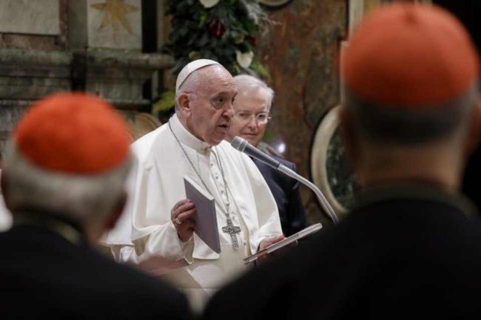 Photo -  Pope Francis holds two books he presented as a gift to cardinals and bishops on the occasion of his Christmas greetings to the Roman Curia, in the Clementine Hall at the Vatican, Saturday, Dec. 21, 2019. (AP Photo/Andrew Medichini, Pool)