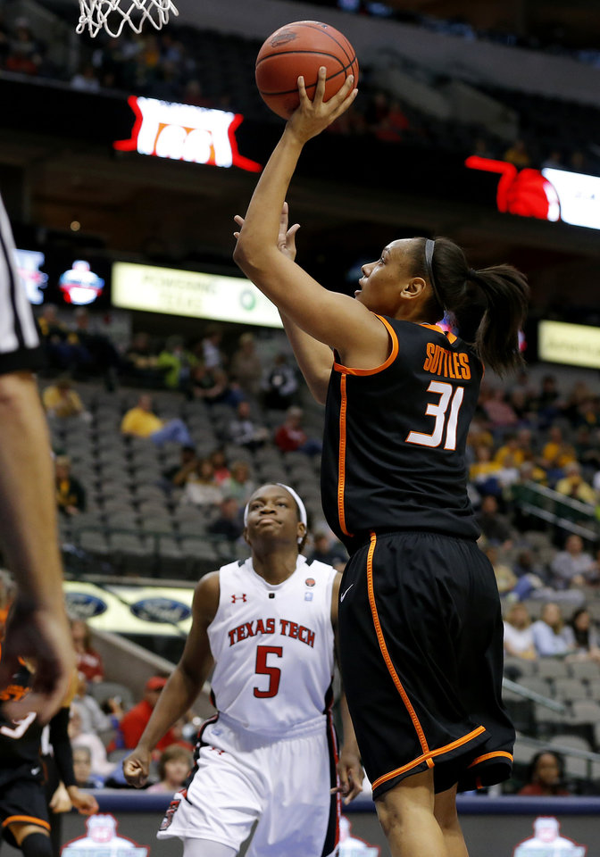 Oklahoma State\'s Kendra Suttles (31) shoots the ball beside Texas Tech\'s Christine Hyde (5) during the Big 12 tournament women\'s college basketball game between Oklahoma State University and Texas Tech University at American Airlines Arena in Dallas, Saturday, March 9, 2012. Oklahoma State won 59-54. Photo by Bryan Terry, The Oklahoman