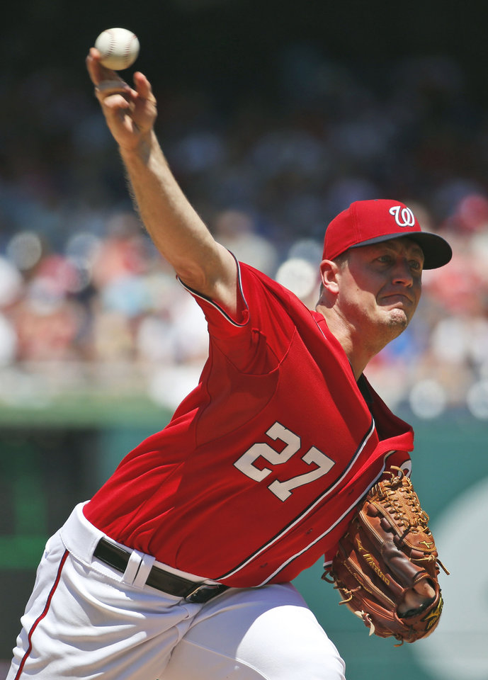 Photo - Washington Nationals starting pitcher Jordan Zimmermann throws during the third inning of a baseball game against the Chicago Cubs at Nationals Park, Sunday, July 6, 2014, in Washington. (AP Photo/Alex Brandon)