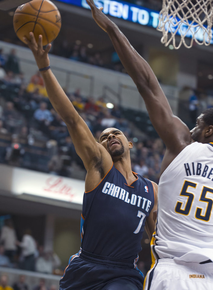Charlotte Bobcats\' Ramon Sessions (7) drives against Indiana Pacers\' Roy Hibbert (55) during the first half of an NBA basketball game in Indianapolis, Saturday, Jan. 12, 2013. (AP Photo/Doug McSchooler)