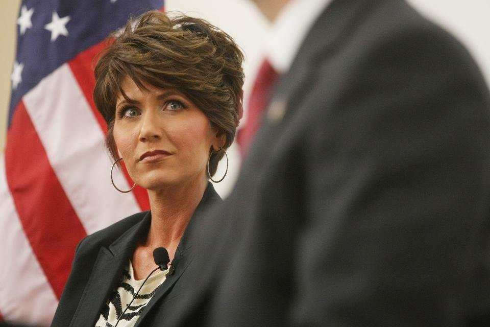 FILE - In this Oct. 12, 2012 file photo Republican U.S. Congressional candidate Kristi Noem looks at her opponent, Democrat Matt Varilek, during a debate in Rapid City, S.D. Noem and Varilek for South Dakota's lone U.S. House seat. (AP Photo, Kristina Barker, File)