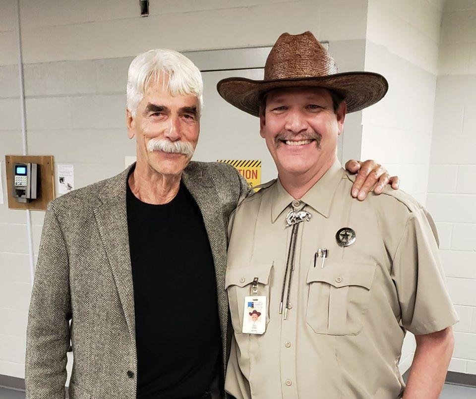 Photo - Tim, right, poses for a photo with Sam Elliott in 2019 at the National Cowboy & Western Heritage Museum. [Photo provided]