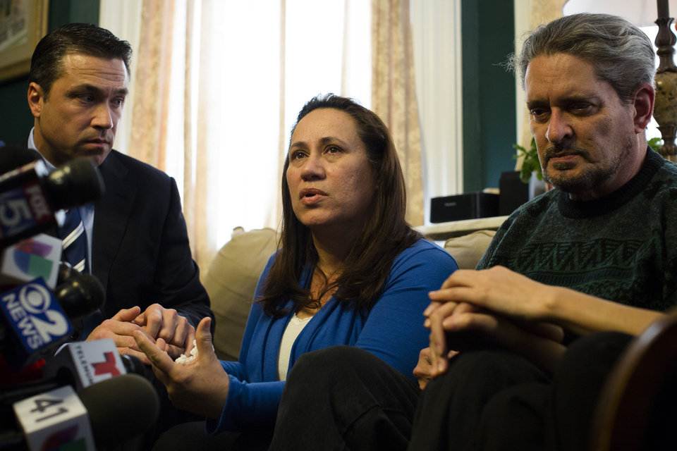 Photo - Betzaida Jimenez, mother of 33-year-old Sarai Sierra who was found dead on Saturday in Turkey, speaks during a news conference at a friend's home in Staten Island alongside Congressman Michael Grimm, left, and her husband Dennis on Monday Feb. 4, 2013, in New York. The New York City woman went missing while vacationing alone in Istanbul on Jan. 21, the day she was due to board her flight back home.   (AP Photo/John Minchillo)