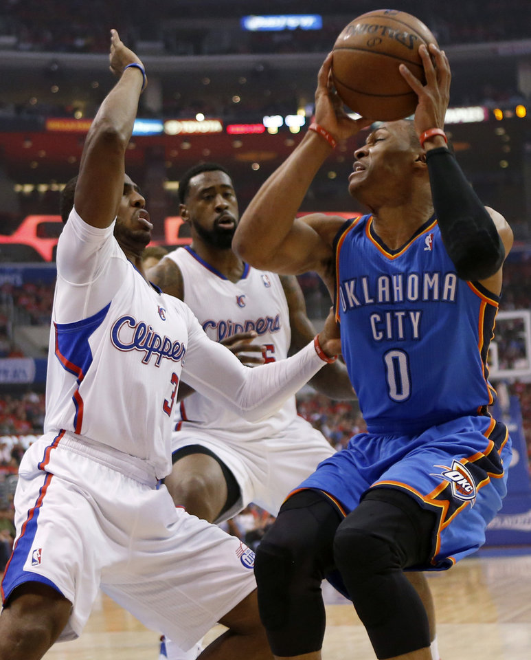 Photo - Oklahoma City's Russell Westbrook (0) is defended by Los Angeles' Chris Paul (3) and DeAndre Jordan (6) during Game 3 of the Western Conference semifinals in the NBA playoffs between the Oklahoma City Thunder and the Los Angeles Clippers at the Staples Center in Los Angeles, Friday, May 9, 2014. Photo by Nate Billings, The Oklahoman