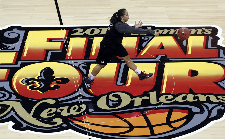Photo - Louisville guard Shoni Schimmel passes the ball during practice at the Women's Final Four of the NCAA college basketball tournament, Saturday, April 6, 2013, in New Orleans. Louisville plays California in a semifinal game on Sunday. (AP Photo/Dave Martin)