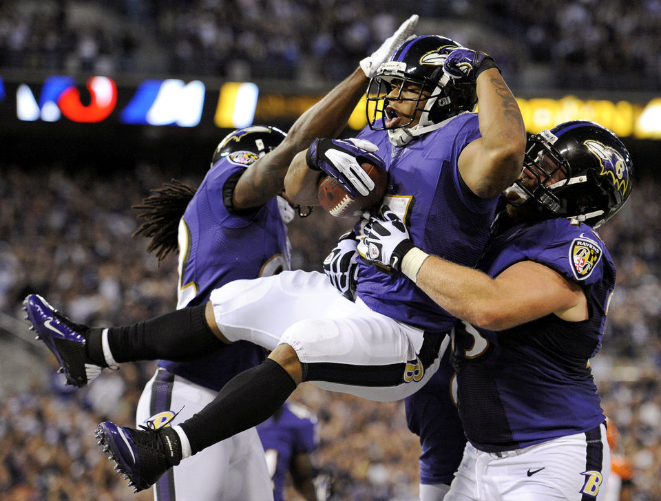 Photo -   Baltimore Ravens running back Ray Rice, center, celebrates his touchdown with Torrey Smith, left, and Marshal Yanda in the first half of an NFL football game against the Cincinnati Bengals in Baltimore, Monday, Sept. 10, 2012. (AP Photo/Nick Wass)