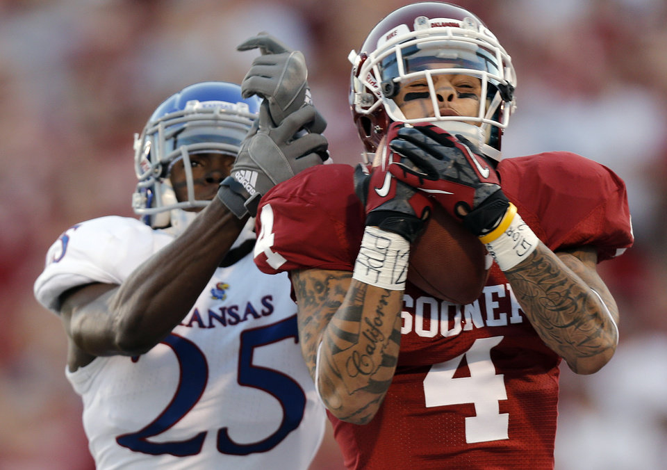 Photo - OU's Kenny Stills (4) catches a touchdown pass in front of KU's JaCorey Shepherd (25) during the college football game between the University of Oklahoma Sooners (OU) and the University of Kansas Jayhawks (KU) at Gaylord Family-Oklahoma Memorial Stadium on Saturday, Oct. 20th, 2012, in Norman, Okla. Photo by Chris Landsberger, The Oklahoman