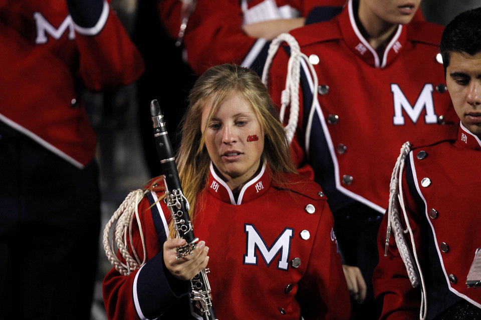 Photo -   Mississippi band members react after their NCAA college football game in Baton Rouge, La., Saturday, Nov. 17, 2012. LSU won 41-35. (AP Photo/Gerald Herbert)