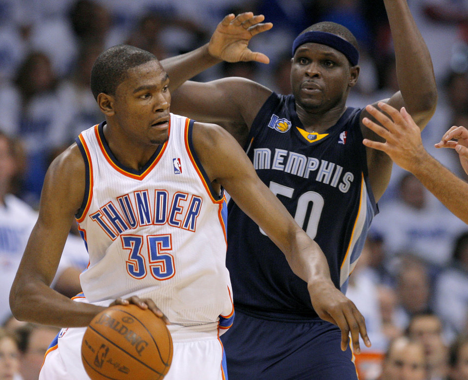 Photo - Oklahoma City's Kevin Durant (35) tries to get past Zach Randolph (50) of Memphis during game five of the Western Conference semifinals between the Memphis Grizzlies and the Oklahoma City Thunder in the NBA basketball playoffs at Oklahoma City Arena in Oklahoma City, Wednesday, May 11, 2011. Photo by Bryan Terry, The Oklahoman