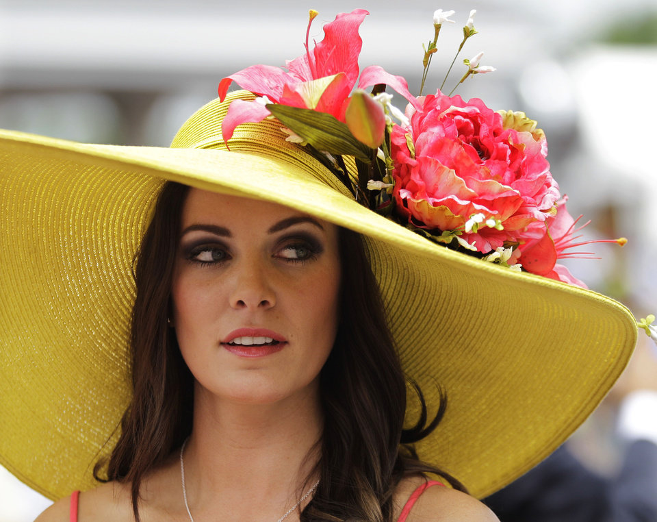 Photo - Tamara Sorrell, from Austin, Texas, wears a fancy hat in the paddocks before the 138th Kentucky Derby horse race at Churchill Downs, Saturday, May 5, 2012, in Louisville, Ky. The Run for the Roses draws them to Churchill Downs. But what race goers wear is as much a spectacle in itself. (AP Photo/Mark Humphrey) ORG XMIT: NY227