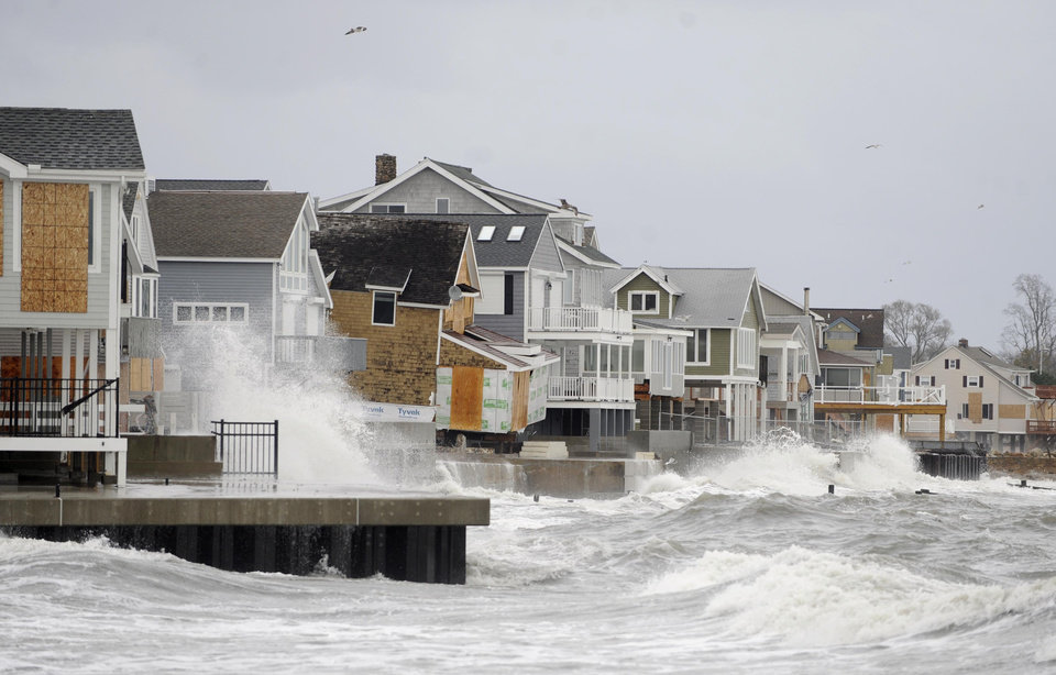 Waves continue to batter homes along the coastline in East Haven, Conn. on Tuesday, Oct. 30, 2012 after superstorm Sandy's peak. (AP Photo/Jessica Hill) ORG XMIT: CTJH112