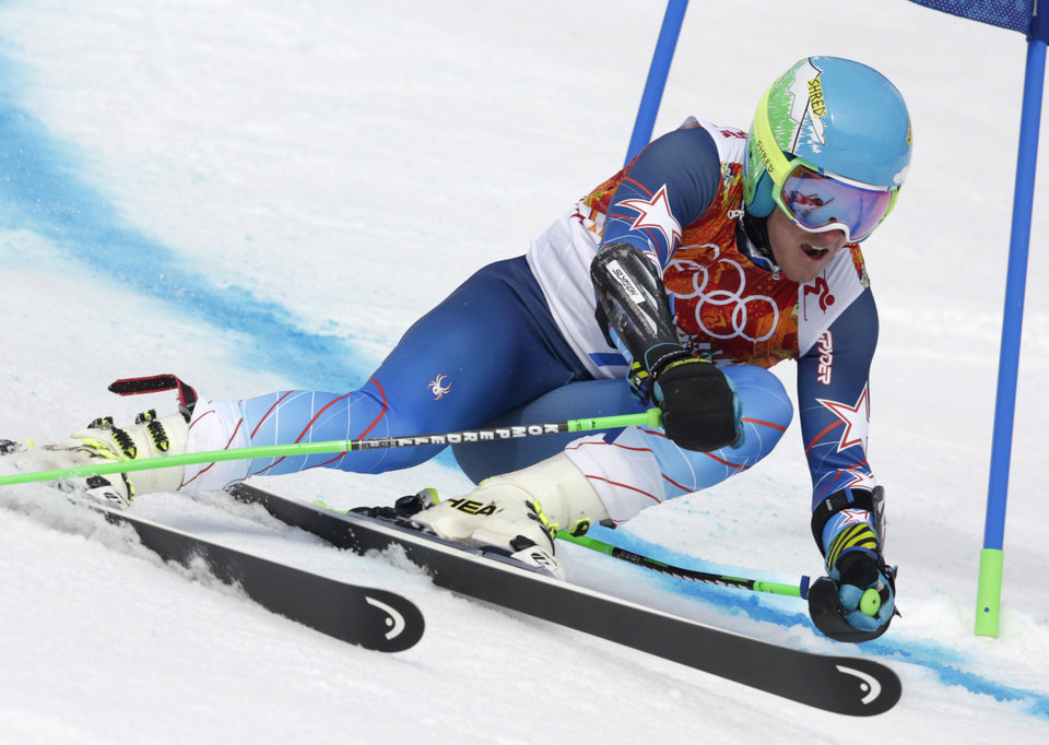 Photo - United States' Ted Ligety passes a gate in the first run of the men's giant slalom at the Sochi 2014 Winter Olympics, Wednesday, Feb. 19, 2014, in Krasnaya Polyana, Russia. (AP Photo/Charles Krupa)