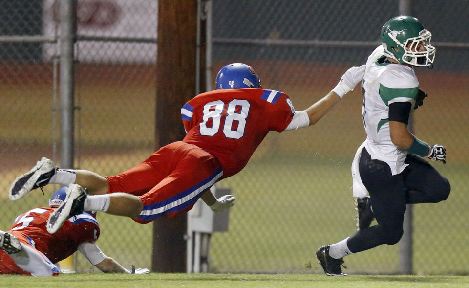 Randal Case of Jones scores a touchdown in front of Jared Goff of Oklahoma Christian School (OCS) during a high school football game in Edmond, Friday, September 14, 2012. Photo by Bryan Terry, The Oklahoman