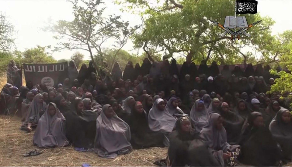 Photo - In this  photo taken from video  by Nigeria's Boko Haram terrorist network, Monday May 12, 2014 shows the alleged missing girls abducted from the northeastern town of Chibok. The new video purports to show dozens of abducted schoolgirls, covered in jihab and praying in Arabic. It is the first public sight of the girls since more than 300 were kidnapped from a northeastern school the night of April 14  exactly four weeks ago. (AP Photo)