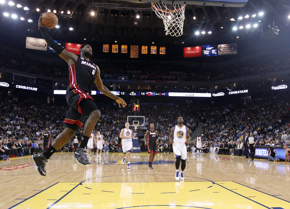 Miami Heat\'s LeBron James (6) goes up for a dunk against the Golden State Warriors during the first half of an NBA basketball game in Oakland, Calif., Wednesday, Jan. 16, 2013. James on Wednesday became the youngest player in NBA history to score 20,000 points. (AP Photo/Marcio Jose Sanchez)
