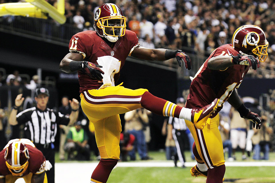 Photo -   Washington Redskins wide receiver Aldrick Robinson (11) celebrates his touchdown with wide receiver Josh Morgan, right, in the first half of an NFL football game against the New Orleans Saints in New Orleans, Sunday, Sept. 9, 2012. The Redskins won 40-32. (AP Photo/Bill Haber)