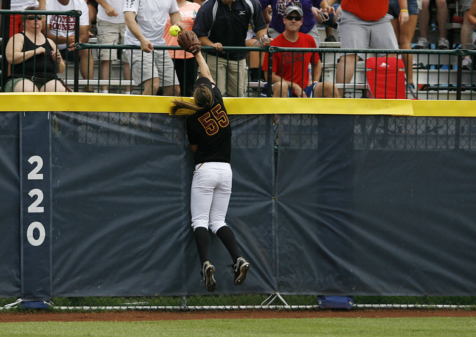 Arizona's Elizabeth Caporuscio (55) misses a catch from a home run hit by Oklahoma's Katie Norris (33) during a Women's College World Series game between Oklahoma University and Arizona State University at ASA Hall of Fame Stadium in Oklahoma City, Sunday, June 3, 2012.  Photo by Garett Fisbeck, The Oklahoman