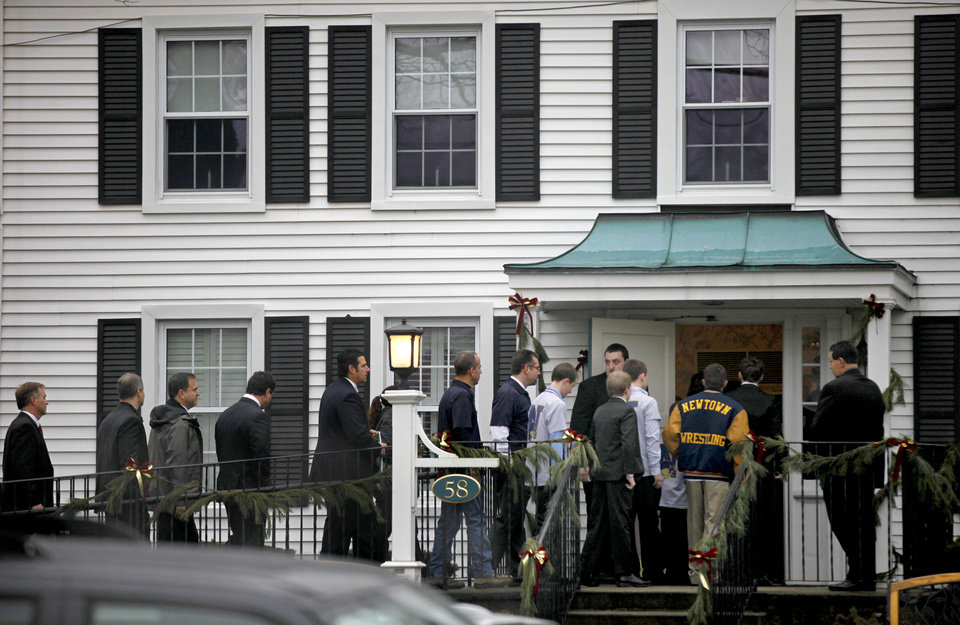 Photo - Mourners arrive for the funeral service of Sandy Hook Elementary School shooting victim, six-year-old Jack Pinto, Monday, Dec. 17, 2012, in Newtown, Conn. A gunman walked into Sandy Hook Elementary School in Newtown Friday and opened fire, killing 26 people, including 20 children.  (AP Photo/David Goldman)