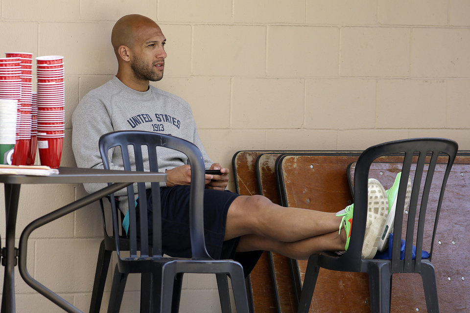 Photo - United States goalie Tim Howard rests before a practice in preparation for the World Cup soccer tournament on Thursday, May 22, 2014, in Stanford, Calif. (AP Photo/Ben Margot)