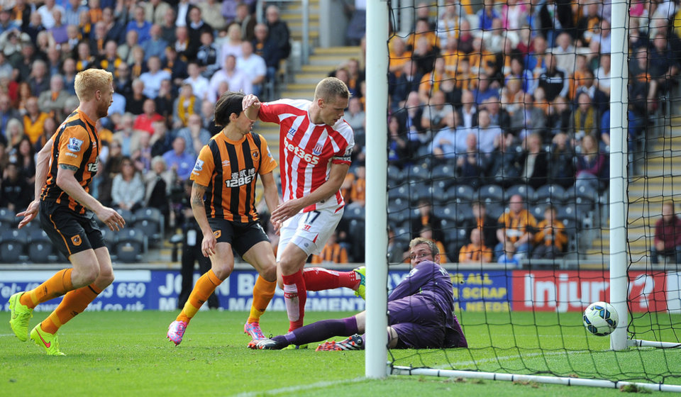 Photo - Stoke City's Ryan Shawcross, centre, scores his teams first goal against Hull City, during their English Premier League match at the KC Stadium, Hull, England, Sunday Aug, 24, 2014. (AP Photo/PA, Martin Rickett)   UNITED KINGDOM OUT  NO SALES  NO ARCHIVE
