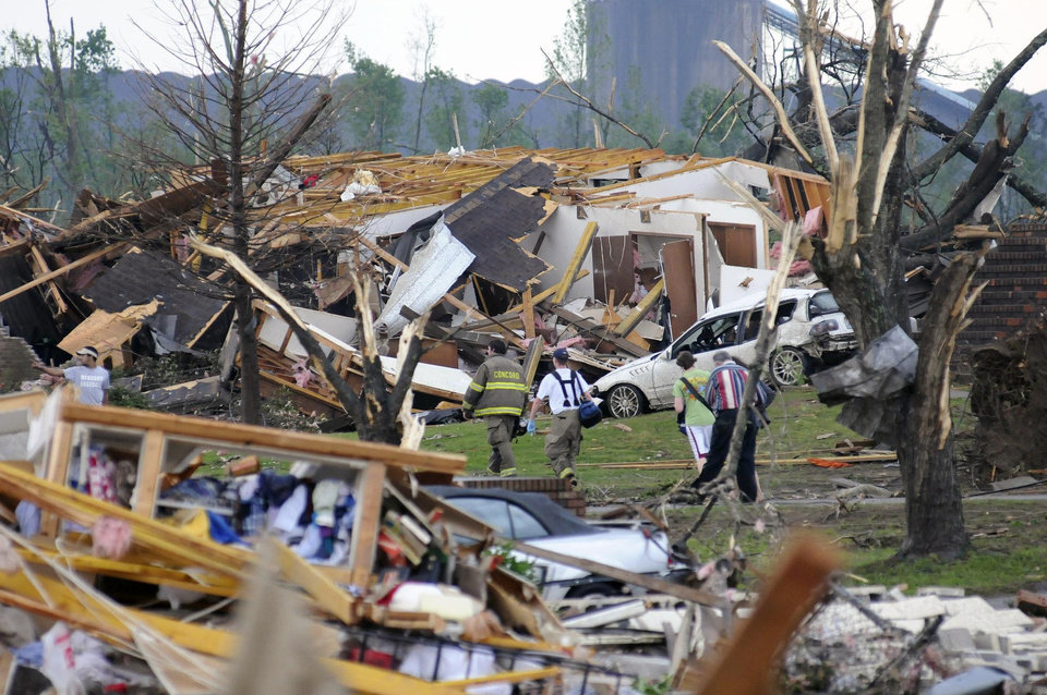 Photo - Emergency responders  search  for injured and missing people near Warrior River Road and Master's Drive, Wednesday, April 27, 2011 in Concord, Ala.. (AP Photo/Birmingham News, Jeff Roberts)