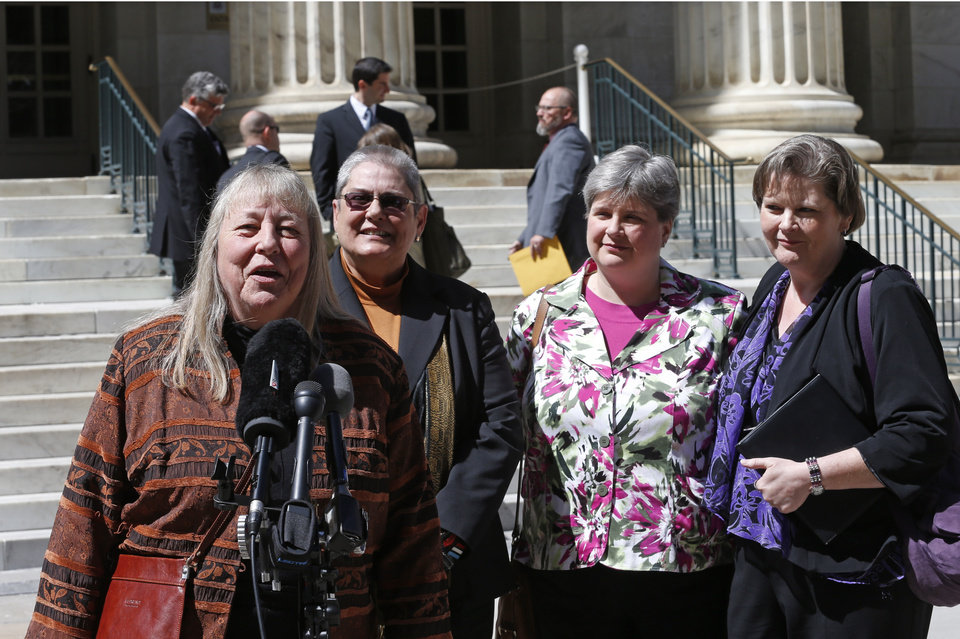 Photo - Plaintiffs challenging Oklahoma's gay marriage ban Dr. Gay Phillips, her partner Sue Barton, Sharon Baldwin and her partner Mary Bishop speaks with members of the media after leaving court following a hearing at the 10th U.S. Circuit Court of Appeals in Denver, Thursday, April 17, 2014. The appeal of a lower court's January ruling that struck down Oklahoma's gay marriage ban is the second time the issue has reached appellate courts since the U.S. Supreme Court shook up the legal landscape last year by finding the federal Defense of Marriage Act was unconstitutional. (AP Photo/Brennan Linsley)