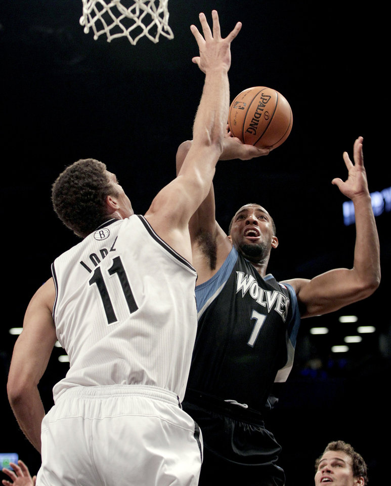 Minnesota Timberwolves' Derrick Williams (7) shoots over Brooklyn Nets' Brook Lopez (11) during the first half of an NBA basketball game, Monday, Nov. 5, 2012, in New York. (AP Photo/Frank Franklin II)