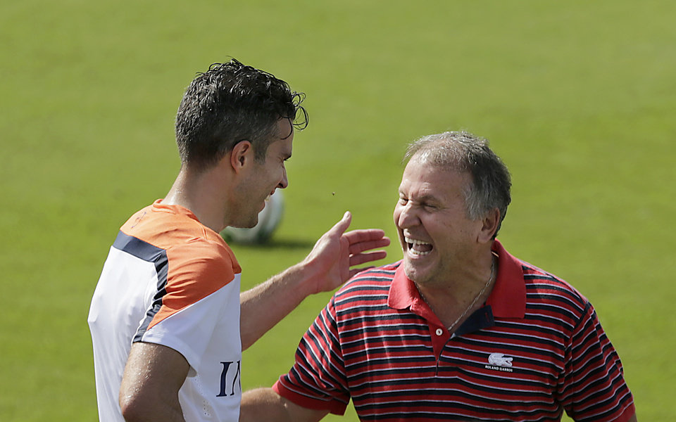Photo - Retired Brazilian striker, Zico, right, shares a light moment with Robin van Persie of the Netherlands after a training session in Rio de Janeiro, Brazil, Thursday, June 26, 2014.  Netherlands will play Group A runner-up Mexico in the second round on Sunday in Fortaleza. (AP Photo/Wong Maye-E)