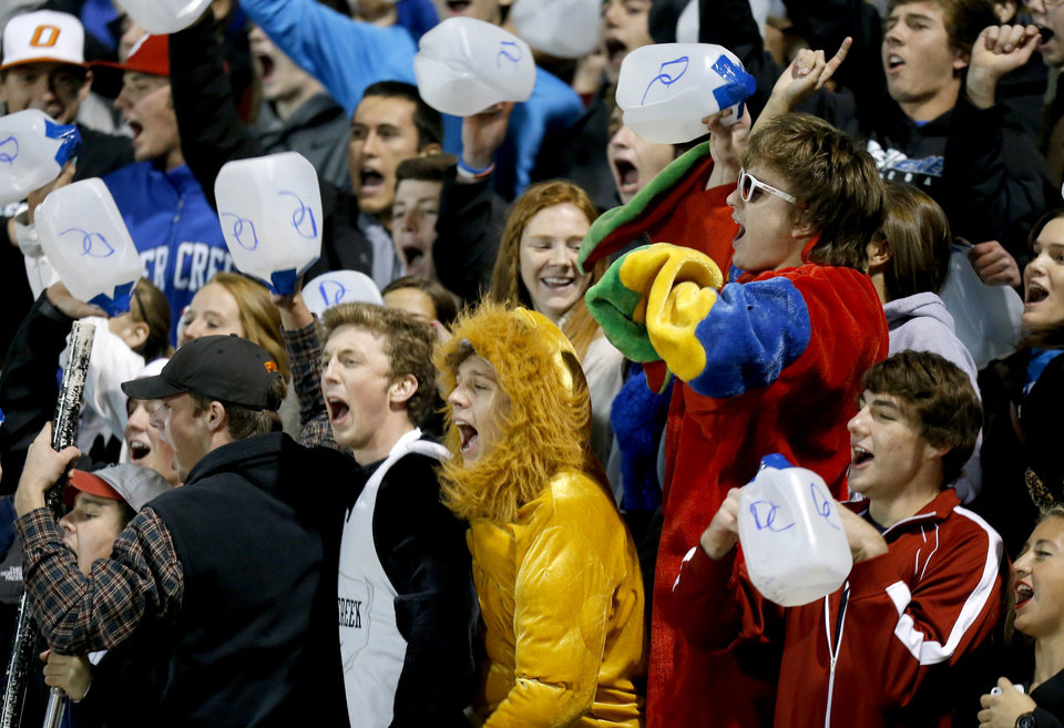 Photo - Deer Creek students cheer during a high school football playoff game at Deer Creek, Friday, Nov. 16, 2012. Photo by Bryan Terry, The Oklahoman