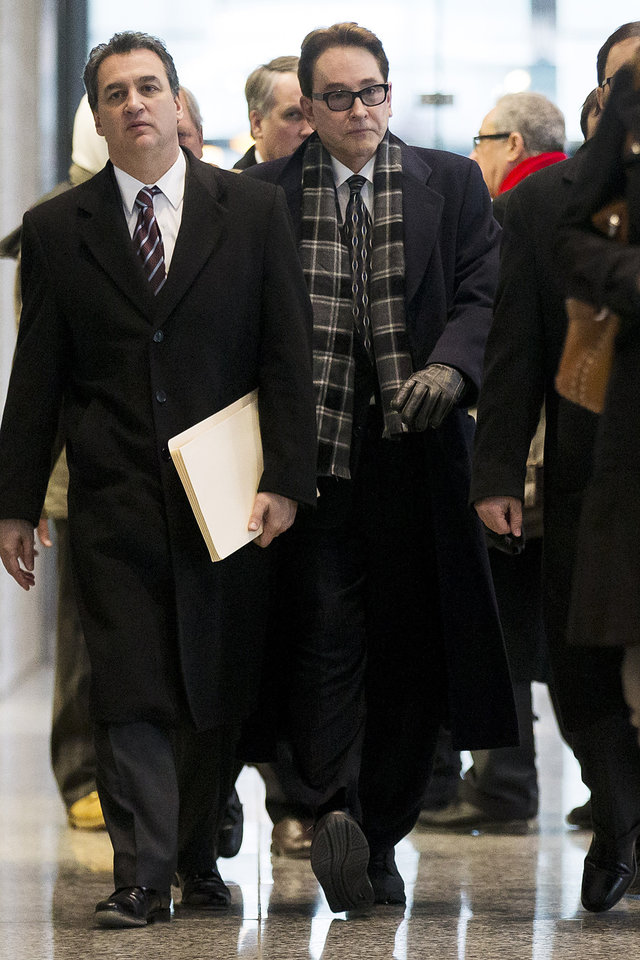 Photo - H. Ty Warner, right, the billionaire who created Beanie Babies, departs from federal court after being sentenced on Tuesday, Jan. 14, 2014, in Chicago. Warner was sentenced to two years of probation, but no prison time, on Tuesday for tax evasion on $25 million in income he had stashed away in Swiss bank accounts.   (AP Photo/Andrew A. Nelles)