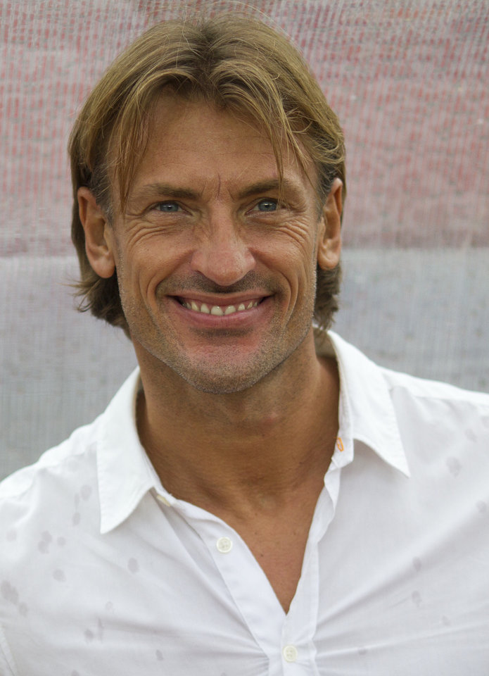 Photo - FILE - In this file photo taken Wednesday, Feb. 8, 2012, Zambia's head coach Herve Renard of France smiles at the start of the African Cup of Nations semifinal soccer match against Ghana in Bata Stadium in Bata, Equatorial Guinea. Renard was appointed Ivory Coast coach on a four-year deal on Thursday, July 31, 2014, succeeding compatriot Sabri Lamouchi who failed to lead the talent-filled West African team past the group stage at the World Cup in Brazil. (AP Photo/Ariel Schalit, File)