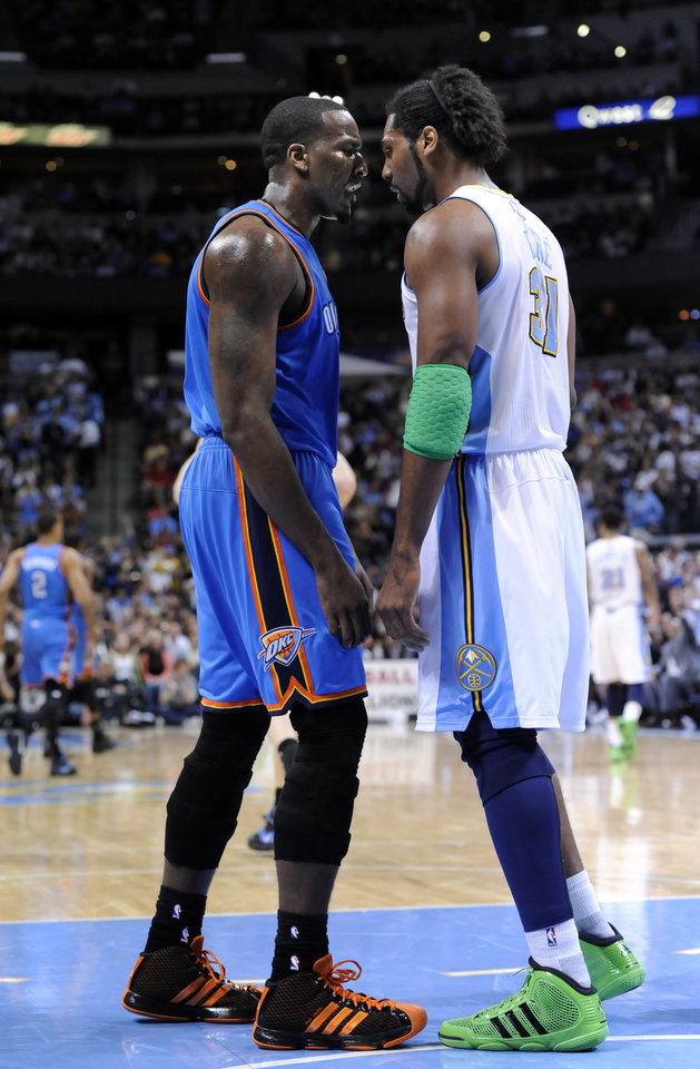 Thunder center Kendrick Perkins (5) and Denver Nuggets center Nene (31) go nose to nose on Tuesday. AP photo